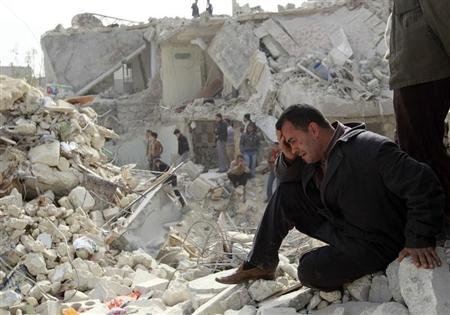 A man cries at a site hit on Friday by what activists said was a Scud missile in Aleppo's Ard al-Hamra neighbourhood