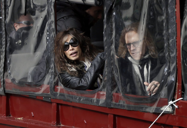 Aerosmith&#39;s Steven Tyler, left, and Tom Hamilton look out from a duck boat as they are transported Monday, Nov. 5, 2012 to Boston&#39;s Allston neighborhood where they gave a free concert. Aerosmith performed in front of the building which was their home in the early 1970&#39;s. (AP Photo/Elise Amendola)