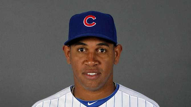 File-This Feb. 27, 2012 file photo shows closer Carlos Marmol of the Chicago Cubs baseball team.  Marmol was traded to the Los Angeles Angels in exchange for pitcher Dan Haren. A person spoke to The Associated Press on condition of anonymity Friday Nov. 2, 2012, because the deal had not been completed yet. (AP Photo/Matt York,File)
