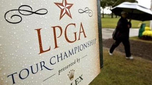 A spectator leaves the golf course while play is suspended due to weather at the LPGA Tour Championship