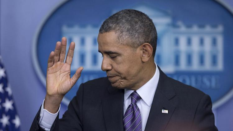 President Barack Obama waves as he concludes speaking in the briefing room of the White House in Washington, Thursday, April 17, 2014. The president spoke about health care overhaul and the situation in Ukraine. (AP Photo/Carolyn Kaster)
