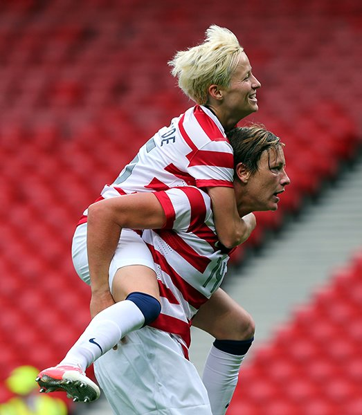Abby Wambach and Megan Rapinoe celebrate a goal in a match against Colombia in this year's London games