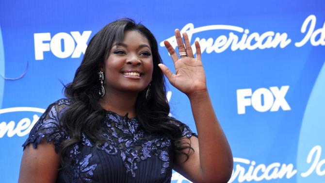 """Candice Glover arrives at the """"American Idol"""" finale at the Nokia Theatre at L.A. Live on Thursday, May 16, 2013, in Los Angeles. (Photo by Chris Pizzello/Invision/AP)"""