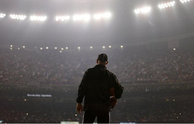 An official looks on during a Superdome power outage in the second half of the NFL Super Bowl XLVII football game between the San Francisco 49ers and the Baltimore Ravens, Sunday, Feb. 3, 2013, in New