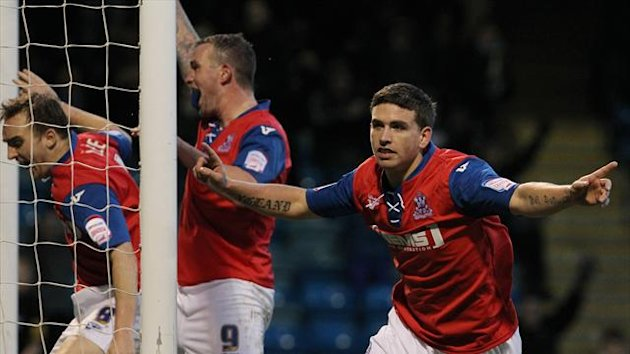 Cody McDonald celebrates scoring Gillingham's equaliser against York