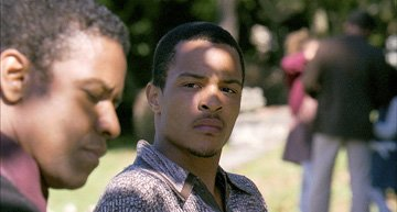 Denzel Washington and Tip 'T.I.' Harris in Universal Pictures' American Gangster