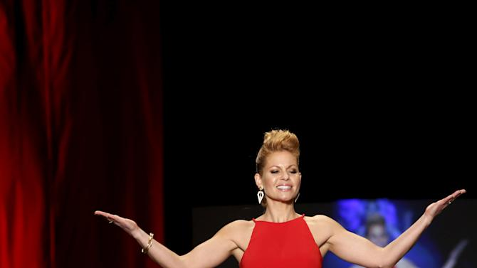 Candace Cameron-Bure presents a creation during the AHA's Go Red For Women Red Dress Collection at New York Fashion Week