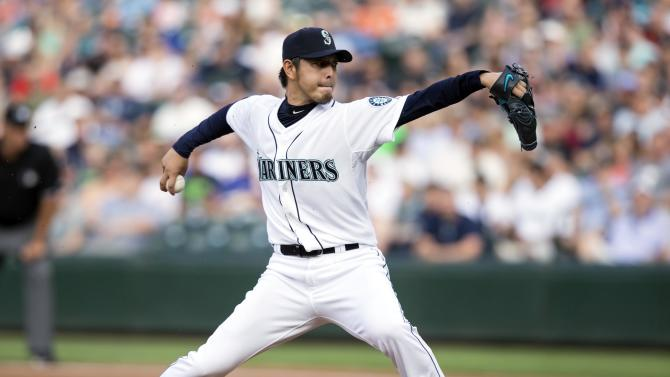 Seattle Mariners starter Hisashi Iwakuma delivers a pith in the first inning of a baseball game, Monday, July 6, 2015, in Seattle. (AP Photo/Stephen Brashear)