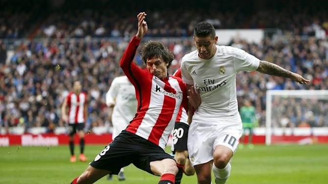 Real Madrid's James Rodriguez and Athletic Bilbao's Ander Iturraspe in action