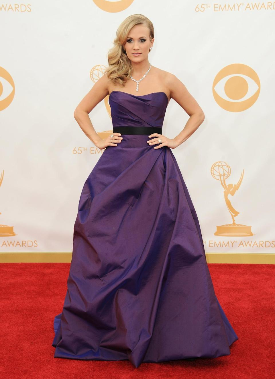 Carrie Underwood, wearing Romona Keveza, arrives at the 65th Primetime Emmy Awards at Nokia Theatre on Sunday Sept. 22, 2013, in Los Angeles. (Photo by Jordan Strauss/Invision/AP)