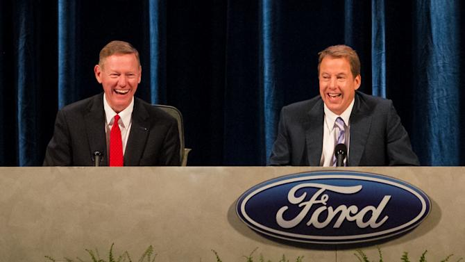 Executive Chairman for Ford Motor Company William Ford, right, and Ford President and CEO Alan Mulally, left, share a laugh during the company's annual shareholders meeting at the Hotel DuPont in Wilmington, Del., Thursday, May 10, 2012. Thursday's meeting lasted only 45 minutes, much of it spent with shareholders praising CEO Alan Mulally and Executive Chairman Bill Ford Jr. for the company's turnaround.  (AP Photo/Ron Soliman)