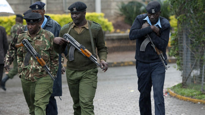Kenyan army soldiers and police officers patrol near the Westgate Mall in Nairobi, Kenya Tuesday, Sept. 24, 2013. Kenyan security forces battled al-Qaida-linked terrorists in an upscale mall for a third day Monday in what they said was a final push to rescue the last few hostages in a siege that has left at least 62 people dead. (AP Photo/Sayyid Azim)