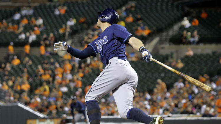 Tampa Bay Rays' Evan Longoria watches his sacrifice fly ball in the fifth inning of a baseball game against the Baltimore Orioles, Thursday, Aug. 28, 2014, in Baltimore. Ben Zobrist scored on the play. (AP Photo/Patrick Semansky)