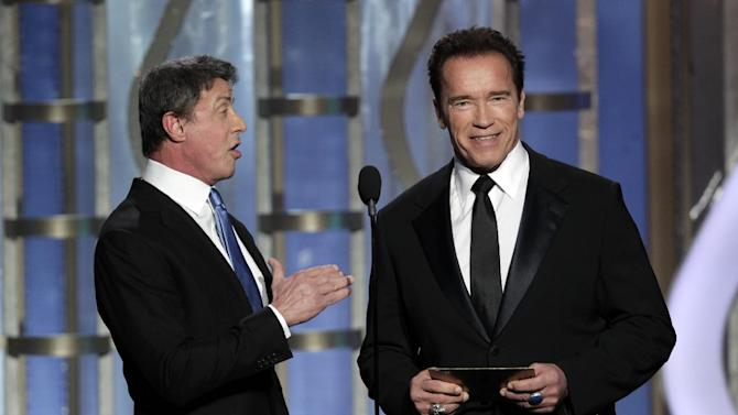 This image released by NBC shows presenters Sylvester Stallone, left, and Arnold Schwarzenegger during the 70th Annual Golden Globe Awards at the Beverly Hilton Hotel on Jan. 13, 2013, in Beverly Hills, Calif. (AP Photo/NBC, Paul Drinkwater)