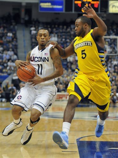 Crowder leads No. 12 Marquette over UConn 79-64