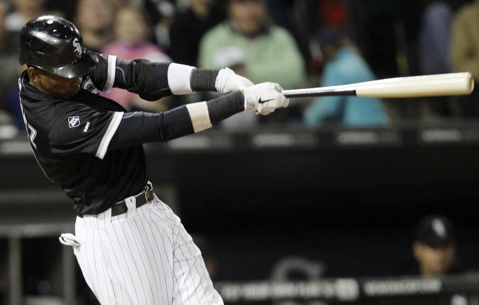 Chicago White Sox's Alexei Ramirez hits a one-run double during the fifth inning of a baseball game against the Cleveland Indians in Chicago, Wednesday, Sept. 26, 2012. (AP Photo/Nam Y. Huh)