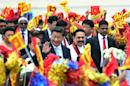 China's President Xi Jinping (C) pictured with Sri Lankan President Mahinda Rajapakse (2R) during a welcome ceremony at the Bandaranaike International Airport in Katunayake on September 16, 2014