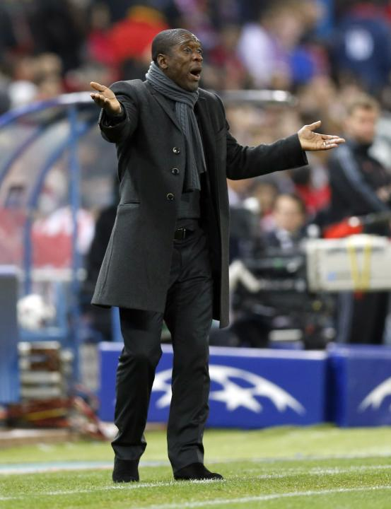 AC Milan's coach Clarence Seedorf gestures to his players during their Champions League last 16 second leg soccer match against Atletico Madrid at Vicente Calderon stadium in Madrid