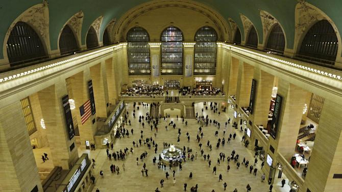 Travelers cross the main concourse of Grand Central Terminal in New York, Wednesday, Jan. 9, 2013, as seen from a bird's eye view through a window near the ceiling. The country's most famous trains station and one of the finest examples of Beaux Arts architecture in America turns 100 Feb. 1.  Its centennial comes 15 years after a triumphant renovation that removed decades of grime and decay. (AP Photo/Kathy Willens)