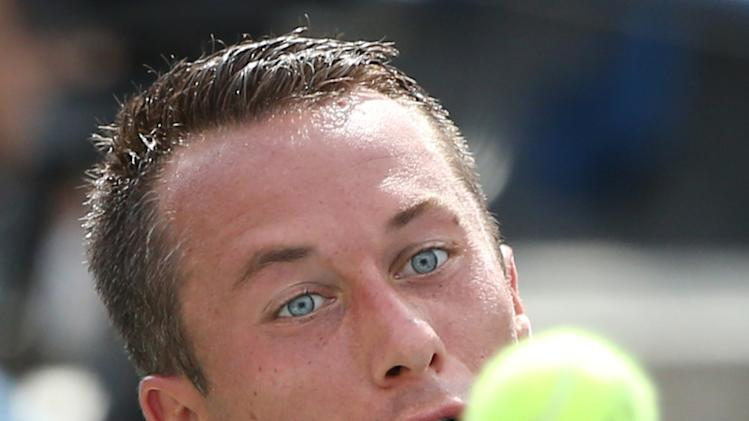 Philipp Kohlschreiber, of Germany, returns a shot against Serena Williams, of the United States, during the fourth round of the 2014 U.S. Open tennis tournament, Monday, Sept. 1, 2014, in New York. (AP Photo/John Minchillo)
