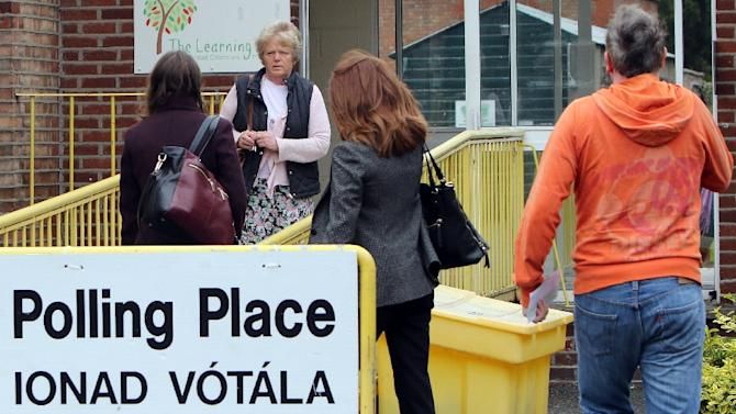 Members of the public arrive to vote at a polling station in Drumcondra, north Dublin, on May 22, 2015