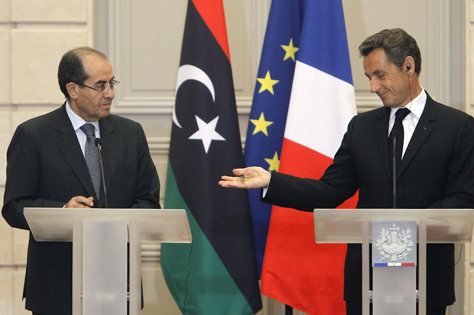 France's President Nicolas Sarkozy, right, gestures  with  the head of Libya's opposition government Mahmoud Jibril during at their meeting at the Elysee Palace in Paris. Wednesday, Aug. 24, 2011. (AP Photo/Jacques Brinon)
