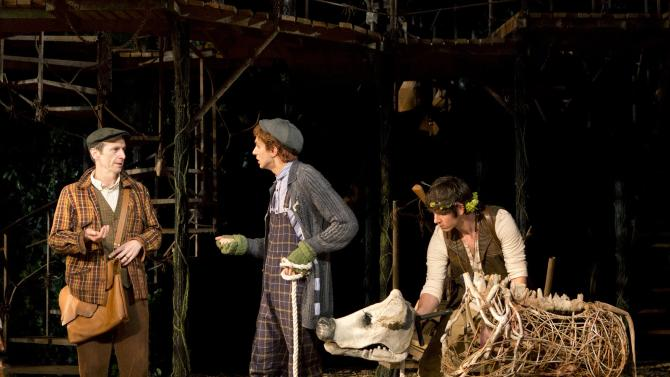 """This undated theater image released by The Public Theater shows actor Denis O'Hare, from left, Gideon Glick, and Johnny Newcomb in The Public Theater's Shakespeare in the Park production of """"Into The Woods,"""" at the Delacorte Theater in New York. O'Hare, who had earned his first ever Emmy nod as a best supporting actor in the FX show """"American Horror Story,"""" is currently on the HBO vampire series """"True Blood.""""  He can also be seen live through Aug. 25, as the Baker in the musical """"Into the Woods,"""" the second show of The Public Theater's 50th Anniversary season at the Delacorte Theater in Central Park. (AP Photo/The Public Theater, Joan Marcus)"""