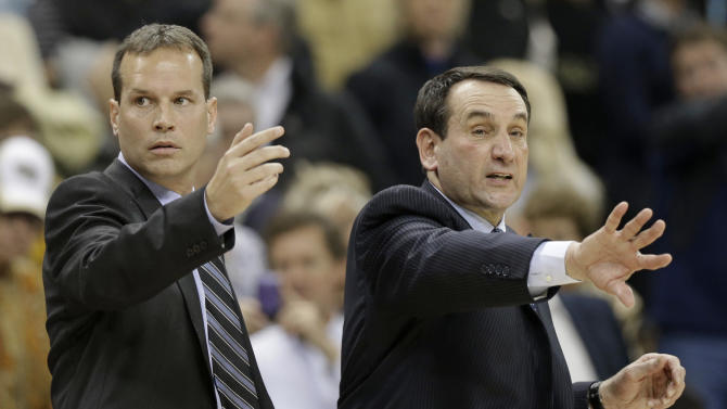 FILE - In this Jan. 30, 2013, file photo, Duke coach Mike Krzyzewski, right, and assistant coach Chris Collins, left, talk to their players during an NCAA college basketball game against Wake Forest in Winston-Salem, N.C., Wednesday, Jan. 30, 2013. Northwestern hired Collins on Tuesday night, March 27, 2013, to replace the fired Bill Carmody, hoping he can finally lead the Wildcats to the NCAA tournament and into the upper echelon of the Big Ten. (AP Photo/Chuck Burton, File)