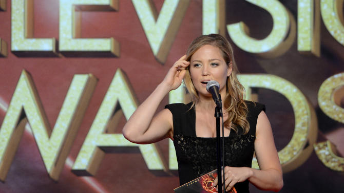 Erika Christensen presents a College Television Award onstage at the 34th College Television Awards presented by the Academy of Television Arts & Sciences Foundation at the JW Marriott Los Angeles L.A. Live on April 25, 2013 in Los Angeles, California. (Photo by Phil McCarten/Invision for the Academy of Television Arts & Sciences/AP Images)