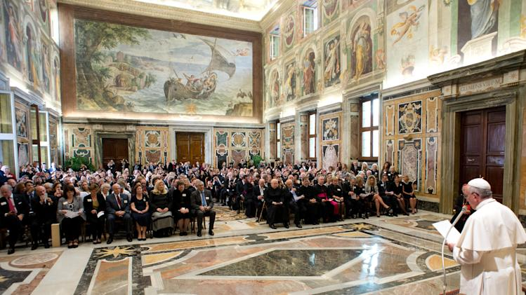 In this photo provided by the Vatican newspaper L'Osservatore Romano, Pope Francis delivers his message to the Patrons of the Arts of the Vatican Museum, a fundraising organization for restoring the Vatican's artistic treasures, on the occasion of their audience, at the Clementine Hall, at the Vatican, Saturday, Oct. 19, 2013. The Patrons celebrated their 30th anniversary with a five-day extravaganza, which included lectures on museum restoration projects, individual chats with Pope Francis, catered dinners in museum galleries, and capped by a private audience with Francis who took time to greet each of the nearly 350 patrons and their families. (AP Photo/L'Osservatore Romano, ho)