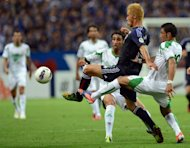 Japan&#39;s midfielder Keisuke Honda (2nd right) traps the ball between Iraqi players during the 2014 FIFA World Cup Asian qualifiers match against Japan in Saitama. Honda has pledged to get his shooting boots on after being chastised by manager Alberto Zaccheroni for failing to score in Japan&#39;s 1-0 win over Iraq in a World Cup qualifying match