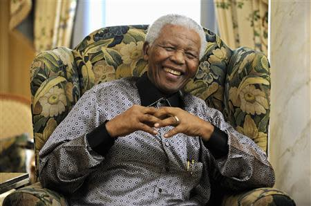 File photo of former president of South Africa Mandela chatting with Britain's Prime Minister Brown in London