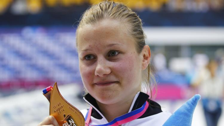 Bronze medallist Punzel of Germany poses with medal after the 1m springboard final at the European Swimming Championships in Berlin