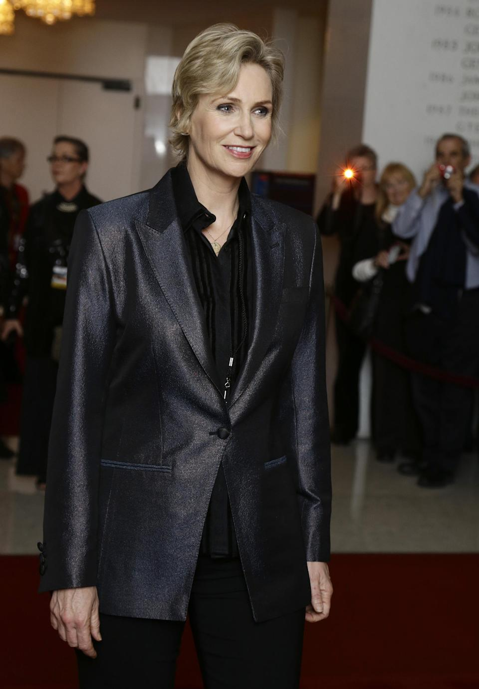 Actress Jane Lynch poses for photographers on the red carpet, before entertainer Ellen DeGeneres receives the 15th annual Mark Twain Prize for American Humor at the Kennedy Center, Monday, Oct. 22, 2012, in Washington. (AP Photo/Alex Brandon)