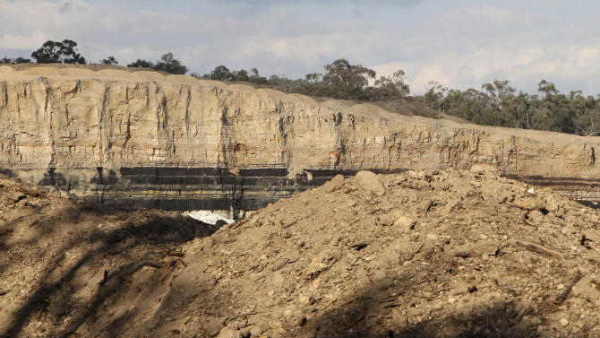 This Tuesday, Sept. 11, 2012 photo shows a coal seam in the bank of an open cut mine near Gunnedah, Australia, 450 kilometers (280 miles) northwest of Sydney. In Australia, where trade with China hit 7.7 percent of GDP last year, exports of coal and iron ore have helped Australia fend off recession for 21 years and deliver the largest trade surpluses in 140 years of record-keeping. (AP Photo/Rob Griffith)