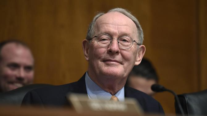 FILE - In this Jan. 21, 2015 file photo, Senate Health, Education, Labor and Pensions Committee Chairman Sen. Lamar Alexander, R-Tenn. listens to testimony on Capitol Hill in Washington. The Tennessee Republican has been playing music, and politics, his whole life, blending the two last month as he practiced an upcoming performance on a borrowed piano in his Senate office. But this week, Alexander's stage is the Senate floor, where he'll do his day job as the top Republican on education issues by managing a bipartisan bill to update the No Child Left Behind Act with a policy giving states more power over their own public schools. (AP Photo/Susan Walsh, File)