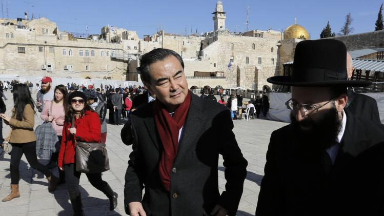 Chinese Foreign Minister Wang is escorted by the Western Wall Rabbi Rabinovitch during his visit to the Western Wall in Jerusalem's Old City