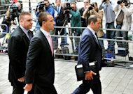 John Terry (right) arrives at Westminster Magistrates&#39; Court on Wednesday morning
