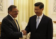China's Vice President Xi Jinping (R) shakes hands with visiting US Defense Secretary Leon Panetta in Beijing. Panetta sought to reassure Beijing over Washington's strategic tilt to the Pacific, telling a military audience it was not an attempt to curb Chinese power