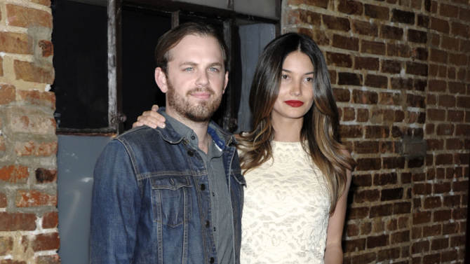 "FILE - This Feb. 9, 2012 file photo shows musician Caleb Followill, left, and his wife, model Lily Aldridge at the premiere of the third season of ""Eastbound and Down"" in Los Angeles. The Victoria's Secret model gave birth to daughter Dixie Pearl Followill on Thursday, June 21, at Vanderbilt University Medical Center in Nashville. (AP Photo/Dan Steinberg)"