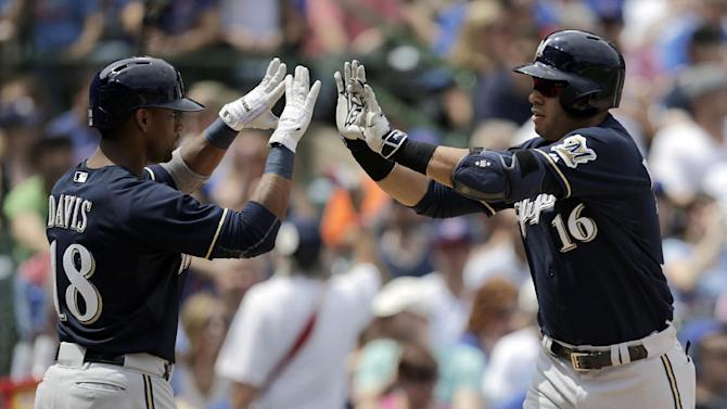 Milwaukee Brewers third baseman Aramis Ramirez (16) celebrates with teammate left fielder Khris Davis (18) after hitting a homerun during the second inning of a baseball game against the Chicago Cubs in Chicago, on Sunday, May 3, 2015. (AP Photo/Jeff Haynes)