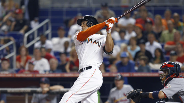 Miami Marlins' Giancario Stanton follows through on a home run during the first inning of a baseball game against the St. Louis Cardinals in Miami, Tuesday, June 26, 2012. (AP Photo/J Pat Carter)