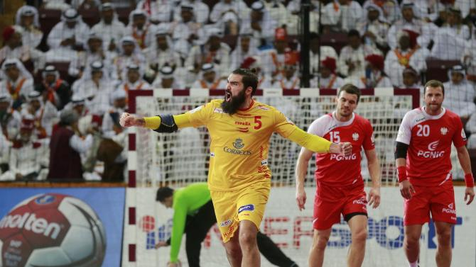 Maqueda of Spain celebrates a goal past Jurecki and Jurkiewicz of Poland during their third-place match of the 24th Men's Handball World Championship in Doha