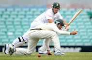 Graeme Smith (rear) clips the ball past Australia A's Rob Quiney at the Sydney Cricket Ground on Saturday. South Africa tucked into some valuable batting practice ahead of next week's opening Test reaching 128 for one after the second day of the three-day tour match