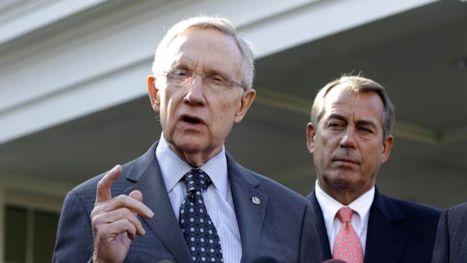 FILE - This Nov. 16, 2012 file photo shows Senate Majority Leader Harry Reid of Nev., left, with House Speaker John Boehner of Ohio looking on, speaking to reporters outside the White House in Washington following a meeting with President Barack Obama to discuss the economy and the deficit. President Barack Obama's re-election has stiffened Democrats' spine against cutting popular benefit programs like Medicare and Social Security. Their new resolve could become as big a hurdle to reaching a deal for skirting economy-crippling tax increases and spending cuts in January as Republicans' resistance raising tax rates on the wealthy.  (AP Photo/Jacquelyn Martin, File)