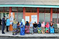 Voters waiting for their turn outside the voting hall at SK Bukit Besar during the Sungai Limau by-election. — Picture by K.E.Ooi