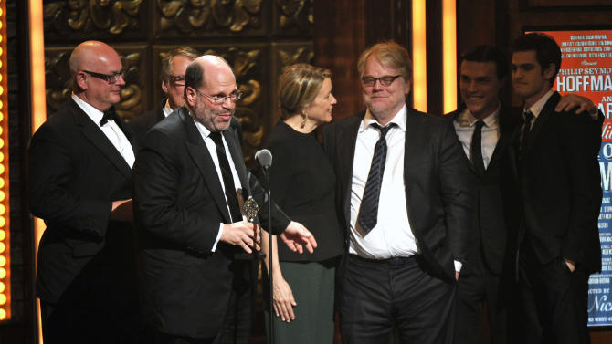 """Producer Scott Rudin, second left, and the cast of """"Arthur Miller's Death of a Salesman,"""" accept the award for best revival of a play at the 66th Annual Tony Awards on Sunday June 10, 2012, in New York.  (Photo by Charles Sykes /Invision/AP)"""