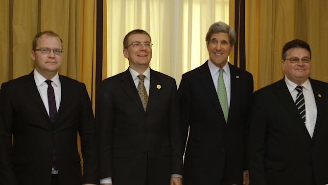 Estonian Foreign Minister Urmas Paet, left, Latvian Foreign Minister Edgars Rinkevics, U.S. Secretary of State John Kerry and Lithuanian Foreign Minister Linas Linkevicius, pose for a photograph before their meeting at the Hotel Excelsior in Rome on Wednesday, Feb. 27, 2013. Rome, where talks will Syria be held, is the fourth leg of Kerry's first official overseas trip, a hectic nine-day dash through Europe and the Middle East. (AP Photo/Jacquelyn Martin, Pool)