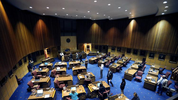 The Arizona Senate breaks for caucus during a special session for Medicaid funding on Thursday, June 13, 2013, in Phoenix. (AP Photo/Matt York)
