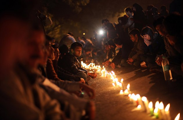 Indians participate in a candle lit vigil as they mourn the death of a gang rape victim in New Delhi, India, Saturday, Dec. 29, 2012. Indian police charged six men with murder on Saturday, adding to a